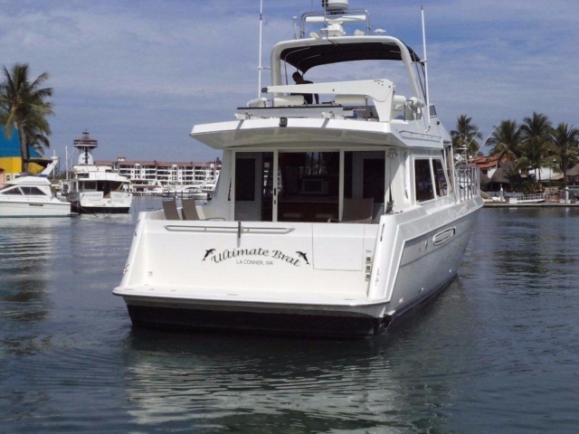 60 ft. Navigator with Fly-bridge - (2 - 25 People) - stern