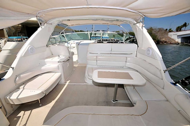 37-ft.-SeaRay-Sundancer---Power-Yacht---Up-to-10-People-Boarding-Deck-under-shade-with-Round-lounges-table-wetbar-Helm-Station