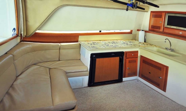 35-ft-Cabo-fishing-yacht-Elegant-integrated-to-Kitchen-Sofa-within-Cabin