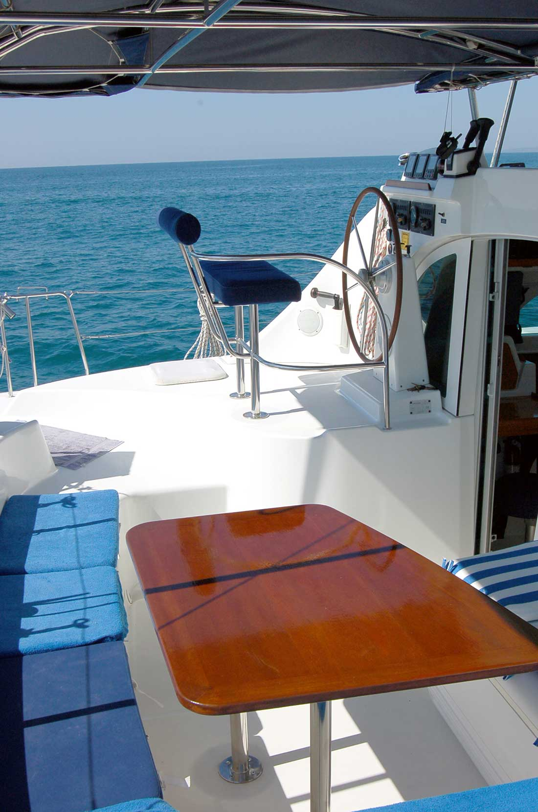 38 FT Lagoon Catamaran - Up to 20 People – (max. 8 to Marieta Islands)-benched-seating-table2